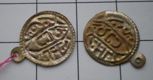 Two small, gold coloured charms