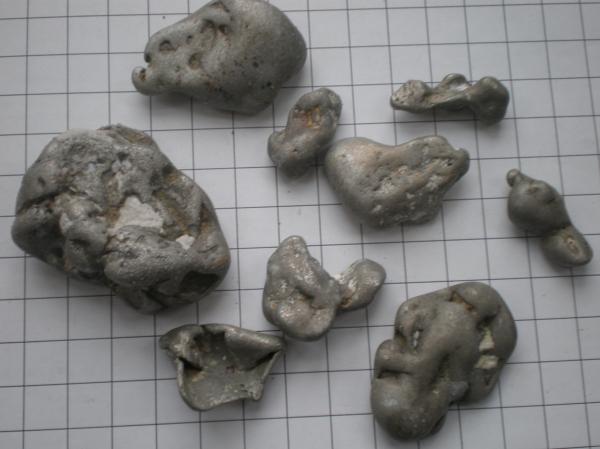 Melted aluminium alloy