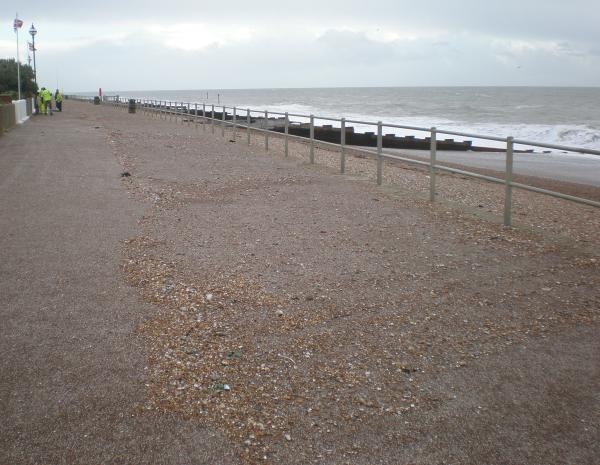 The prom is covered in shingle. The cleanup begins.