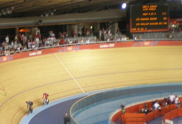 Eddie Dawkins (NZ) leads Phillip (Trinidad and Tobago) on the first bend. Men's Sprint, round of 16