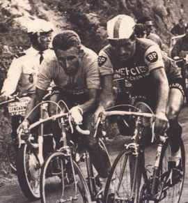 Jacques Anquetil and Raymond Poulidor battle it out on the climb on the Puy de Dôme during the 1964 Tour de France